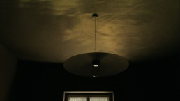 An image of a light fitting in a darkened room