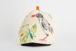tea cosy with a sea bird painted on it